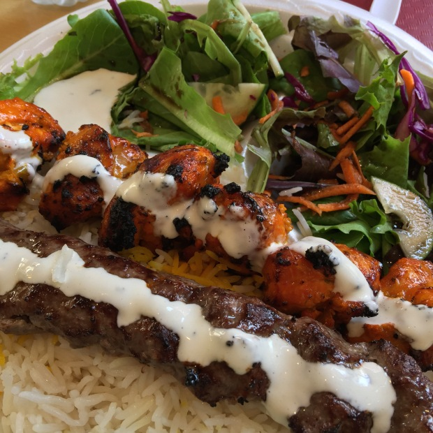 Beef koobideh, chicken breast kabob, buttery rice, a pleasantly vinegary salad, and a touch of yogurt sauce made a really nice lunch.